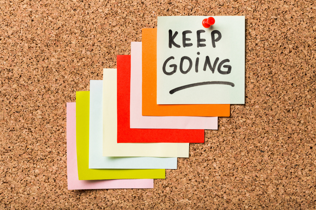 Post-it notes that say Keep Going!