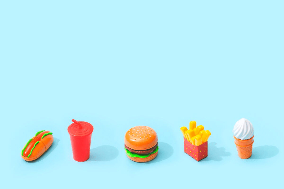 Miniature fast food in a line.