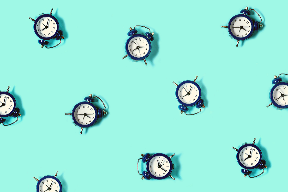 Blue clocks on a light blue background.