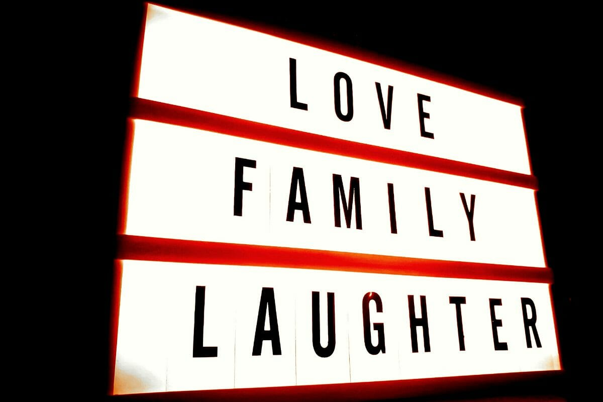 Sign that says Love Family Laughter